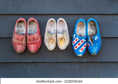 Traditional dutch wooden clogs hanging at a wall in Netherlands