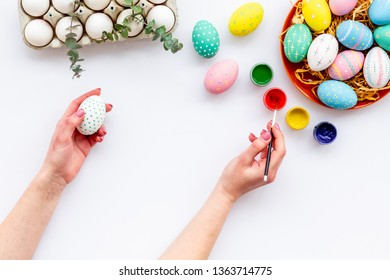Traditional Easter eggs for paint on white background top view