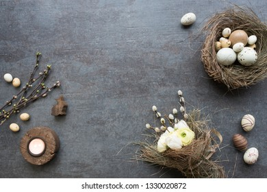 Traditional easter symbols decorated on gray stone plate