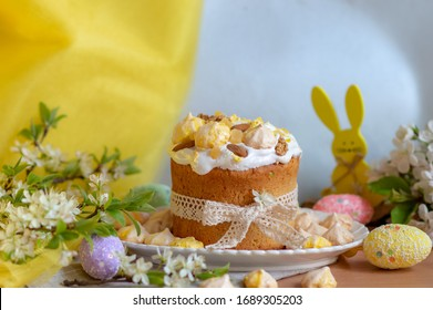 Traditional Easter treat Easter cake decorated with glaze, meringues, candied fruit and almonds. Easter at home. Easter celebration concept