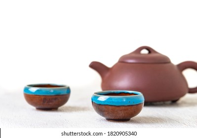 traditional eastern teapot and teacups on white wooden desk