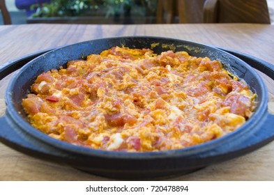 Traditional egg tomato onion menemen cooking for breaskfast serving in istanbul turkey
