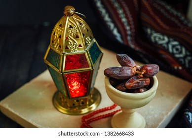 Traditional Egyptian vintage lamp with dates served in an earthen bowl. Ramadan Kareem background photo.