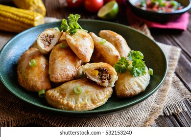 Traditional Empanadas stuffed with minced beef, pepper and corn, served with Aji Picante sauce