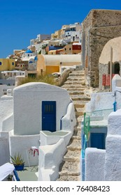 Traditional empty street with beautiful architecture on island of Santorini in Fira, Greece.
