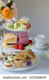 Traditional english afternoon tea with cakes and sandwiches