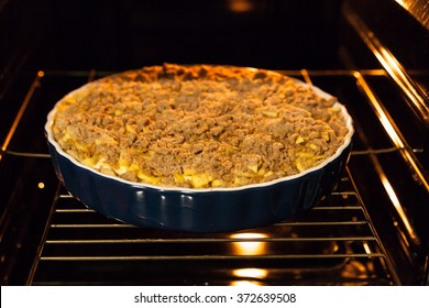 Traditional English apple crumble pie  in the oven