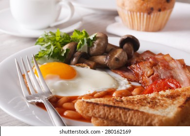 Traditional English breakfast: eggs with bacon and vegetables close-up on a plate. horizontal
