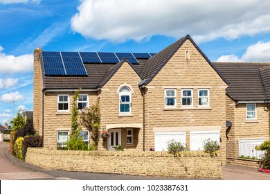 Traditional english house with solar panels