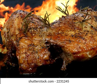 Traditional English wine marinade roast by romantic fire, conceptual sunday or xmas lunch macro close up with copy space