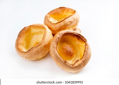 Traditional English Yorkshire pudding as close-up on white background â?? covered
