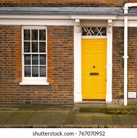 Traditional entrance door of yellow colour in london