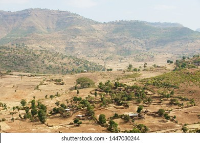Traditional Ethiopian wooden village houses with straw roofs in the valley near Gondar, Ethiopia.