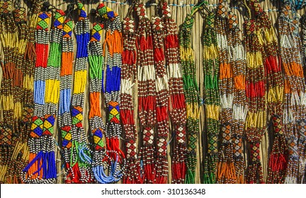 Traditional ethnic african handmade colorful beads necklace. Unique craftsmanship. Local craft market in South Africa.