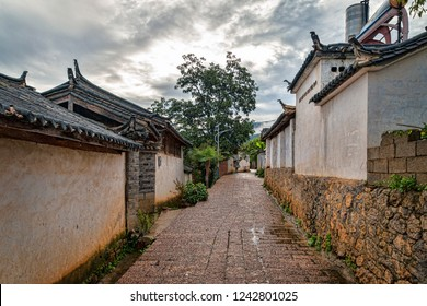 Traditional Ethnic Naxi Village. Historic Chinese Village Center with Stone Streets and Homes in Ancient Architectural Style. Summer Day, No People. (Nanyao Village, Lijiang County, Yunnan, China).