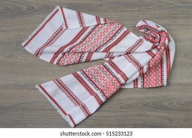Traditional ethnic slavian towel on wooden table