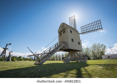 """Traditional European styled windmill is a """"postmill"""" as the entire wooden structure would rotate on a massive wooden post so the blades would always face the wind. Etzikom, Alberta, Canada"""