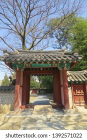 The traditional exterior design from the door, wall and delicate carving dancheong painting attest to the dynasty's authority at Gyeonggijien Shrine at Jeonju, South Korea