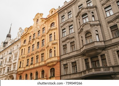 Traditional facade of buildings, exterior of buildings in Prague. Close-up of beautiful historic buildings standing tightly together