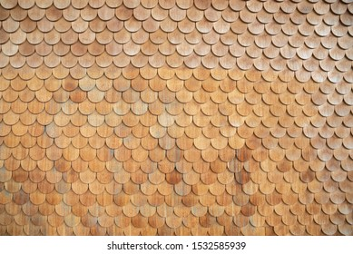 Traditional facade cladding with brown roof shingles