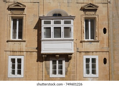 Traditional facade of a Malta building with white frames