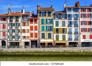 Traditional facades with colorful windows in Bayonne, Basque Country, France