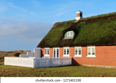 Traditional family house with thatched roof on the North Sea Island Fanoe, Denmark
