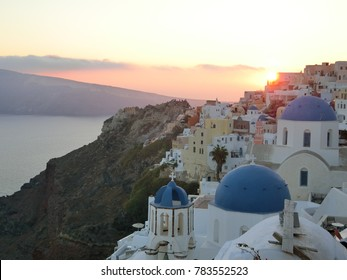 Traditional and famous houses and churches with blue domes over the Caldera Oia, Santorini Greece