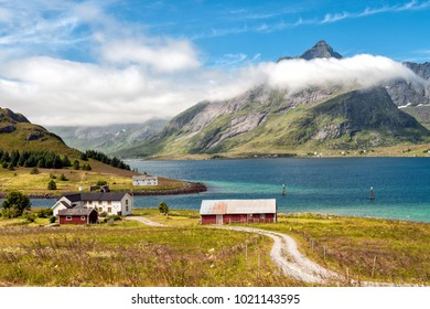 Traditional farm buildings in coast landscape on Lofoten islands in northern Norway. Lofoten is a popular tourist destination.