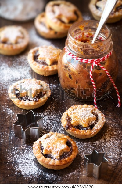 Traditional festive Christmas mince pies with a jar of homemade mincemeat cooking process