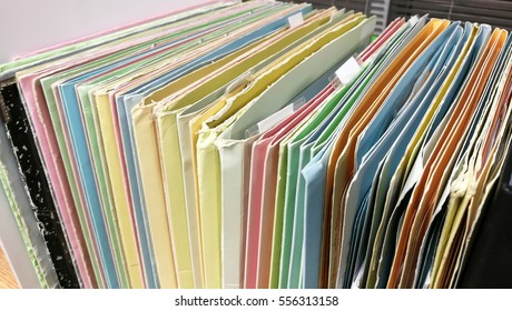 Traditional filing cabinets filled with files of several colors.Abstract background image of colorful hanging file folders in drawer.