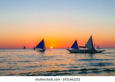 Traditional filipino boat at the idyllic white sand beach at Boracay island in Philiphines - Shutterstock ID 1931462231