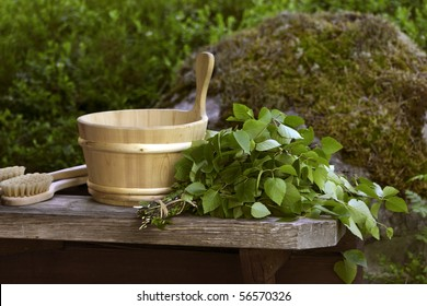 Traditional Finnish birch sauna whisk and wooden water pall