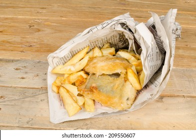 Traditional fish and chips wrapped in a newspaper cone