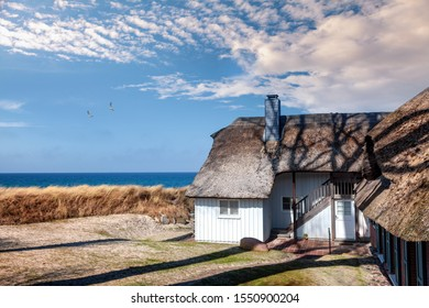 Traditional fisherman's house in the dunes of the Baltic Sea