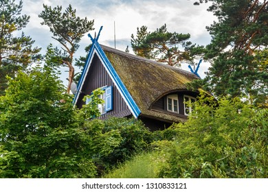 Traditional fisherman's house in Nida, Lithuania.  Nida is a resort settlement on the Curonian Spit in Lithuania.