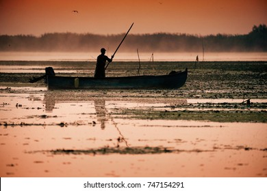 Traditional fishermen catching fish at sunrise in Delta Dunarii, Romania