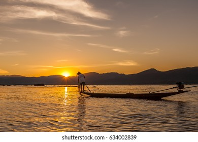 Traditional fishermen at sunset on the Inle Lake in Myanmar