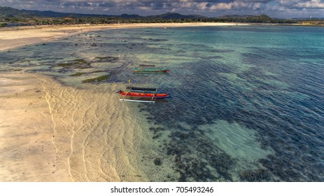 Traditional fishing boat in beautiful Lombok beach with clear water aerial photography from drone camera