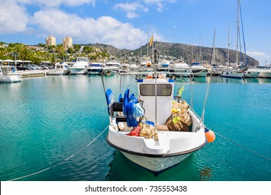 Traditional fishing boat docked at Moraira port, Costa Blanca, Spain