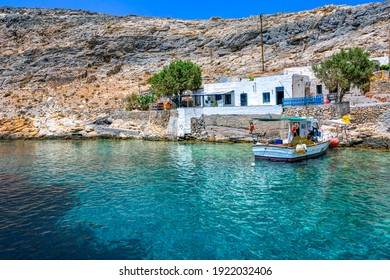 Traditional fishing boat at Heronissos small village, with clear transparent waters, in Sifnos island, Greece