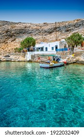 Traditional fishing boat at Heronissos small village, with transparent waters, in Sifnos island, Greece