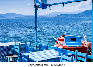 Traditional fishing boat lying in the harbor of Trikeri on the greek peninsula Pilion