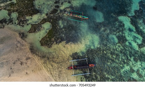 Traditional fishing boat on the beach with clear water Aerial photography from drone camera
