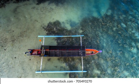 Traditional fishing Boat on the beach clear water aerial photography from drone camera