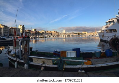 Traditional fishing boat on the quay of the old port of Marseille, France in the early morning