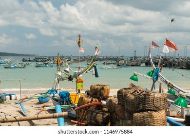 Traditional fishing boats and baskets at the picturesque fishing port of Jimbaran, Bali.