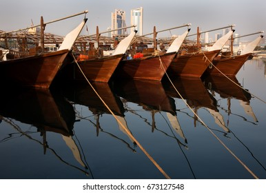 Traditional fishing boats (dhow) in the Fishing harbor of Manama, Bahrain