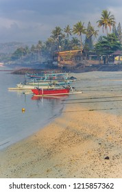 Traditional fishing boats in early morning light at the coast of Candidasa, Bali, Indonesia