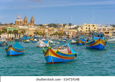 Traditional fishing boats Luzzu moored at Marsaxlokk Harbor, Malta